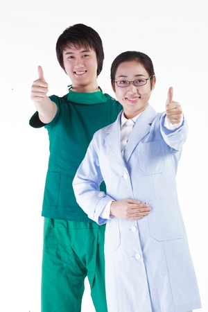 md: A male surgeon and a female doctor showing thumbs up to the front