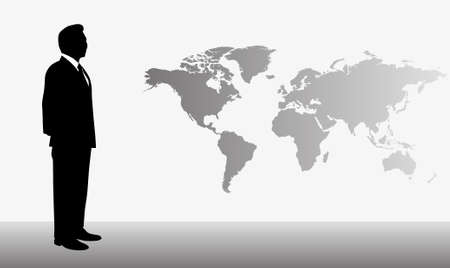 Silhouette of businessman with world map in the background