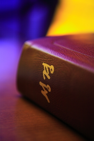 Close up shot of the closed bible laid on the desk