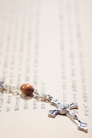 hallowed: Isolated shot of the rosary laid on the bible Stock Photo