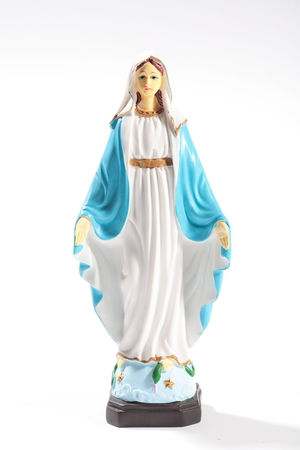 Full shot of Table statue of Virgin Mary in white background Stock Photo