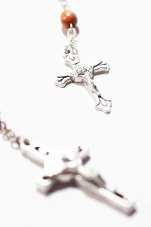ロザリオの十字架の分離のショットのショットを閉じる