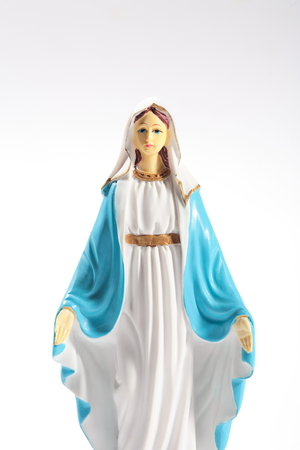 Table statue of Virgin Mary in white background Stock Photo