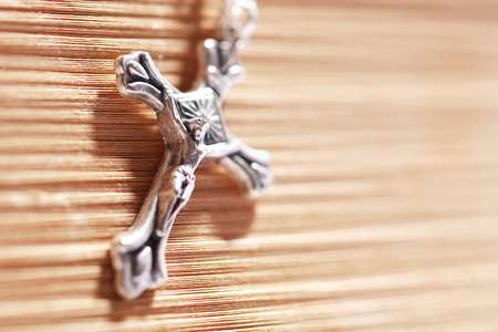 Isolated shot of the rosary laid on the bible Stock Photo