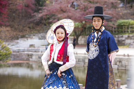 hanbok: Young Asian newlywed couple in Hanbok, Korean traditional clothes taking selfies in Hanok, Korean traditional house Stock Photo