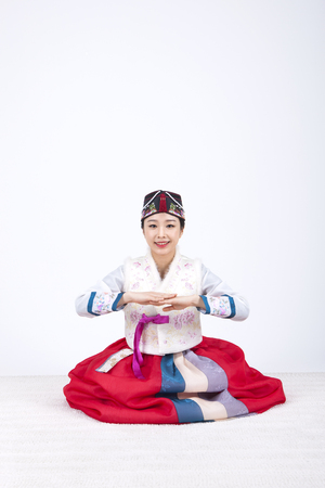 hanbok: Young Asian woman in Hanbok, Korean traditional clothes, posing in the studio - isolated on white