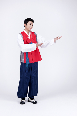 republic of korea: Young Asian man in Hanbok, Korean traditional clothes, posing in the studio - isolated on white