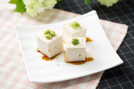 Slow food - Bean curdtofu with green peas shot in studio Фото со стока