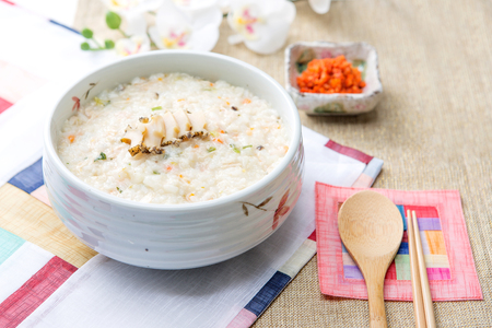 Slow food - abalone rice soup/porridge shot in studio Imagens - 85173930