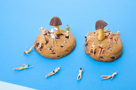 Creative miniature life - Peopletravelerstourists in bathing suis on vacation on the beachisland Stock Photo