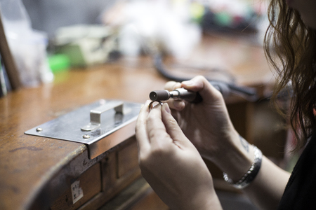jewerly: Isolated shot of hands of handmade craft jewerly experts making a piece withusing toolsmachines