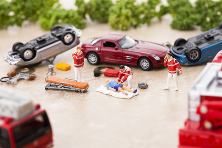 Creative miniature life - Firefightersparamedics saving a man from car accident