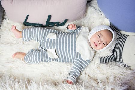 Baby studio photoshoot - Isolated shot of Asian babyinfant lying on back
