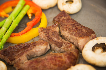 carnes y verduras: Isolated shot of cooks hands cooking beef