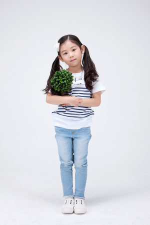 Isolated shot in studio - little Aisan girl posing with various props