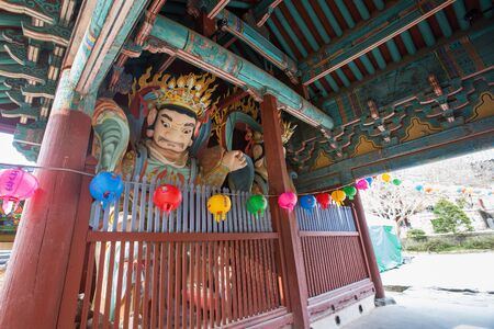 Buddhist temple in Korea - Round shape colorful lanterns and sculptures of heavenly kings