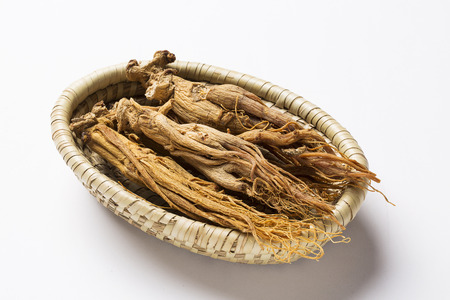 dried red ginseng,on basket - isolated on white