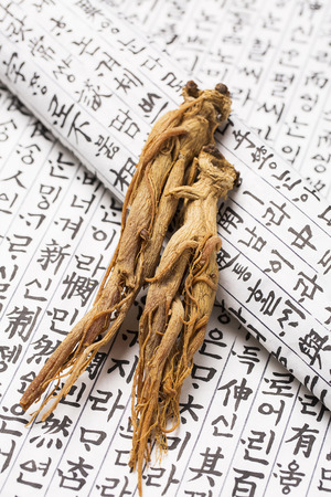 Dried red ginseng on Korean ancient paper