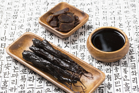 Honey marinated red ginseng, honey red ginseng slices and red ginseng extract on Korean ancient paper