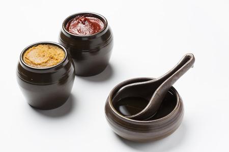 Gochujang(Korean chilli paste), Doenjang(Korean soybean paste) and soy sauce - isolated on white