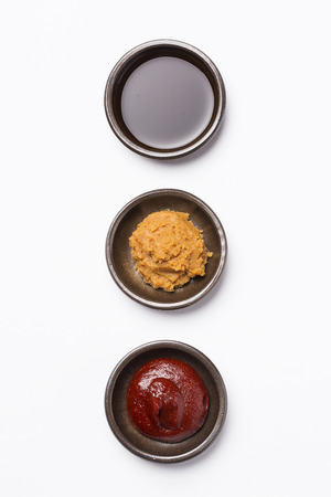 Gochujang(Korean chilli paste), Doenjang(Korean soybean paste) and soy sauce - isolated on white