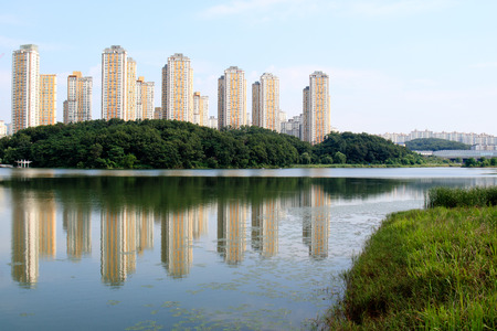Tall apartment buildings over the lake