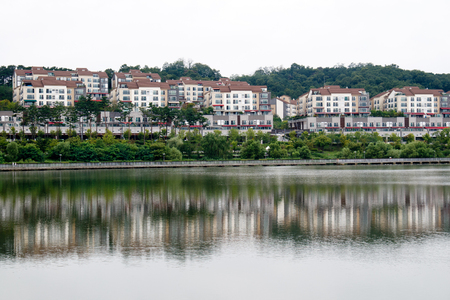 public housing: Town house over the lake in South Korea Editorial