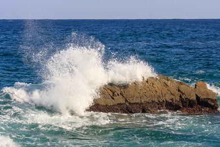 Coast sea in autumn - scenery of breaking waves