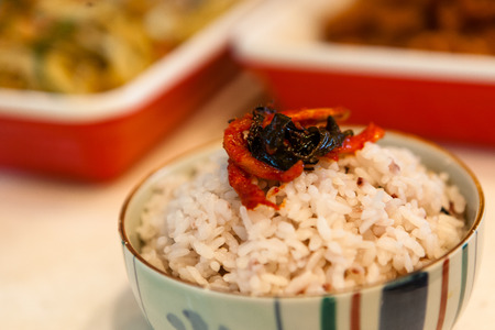 Korean dishes - a bowl of white rice with side dishes Stock Photo