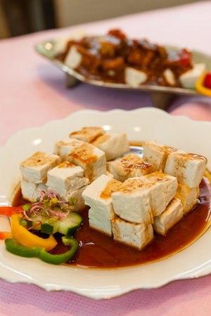 Korean side dishes - diced tofu and soy sauce Stock Photo