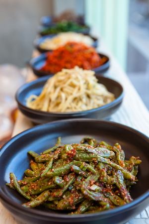 Korean side dishes - served in clay plates