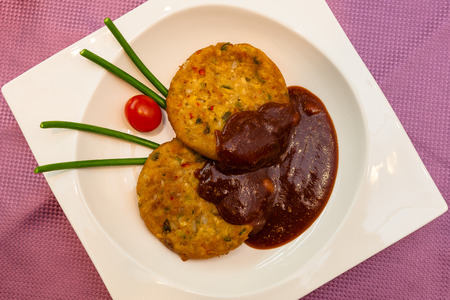 Korean dishes - pan fried patties of chopped meat and greens