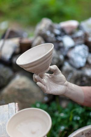 Korean folk village - Pottery bowls being laminated with liquid ceramic Imagens