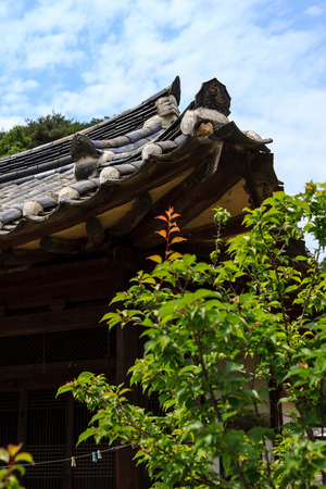 Close up shot of eaves of tiled roof Stock Photo