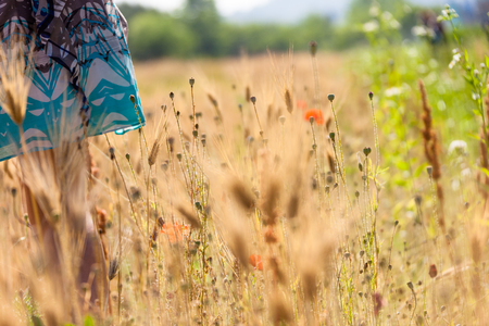 The isolated shot of a womans lower body standing in the grass field Stock Photo