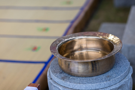 Small basin of water for washing up at the altar