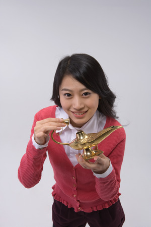 Asian woman posing in a studio with aladdin lamp