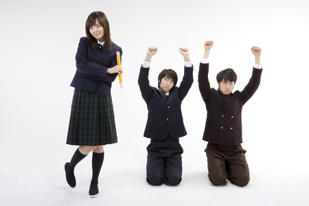 Two young Asian male students and a female student posing in a studio