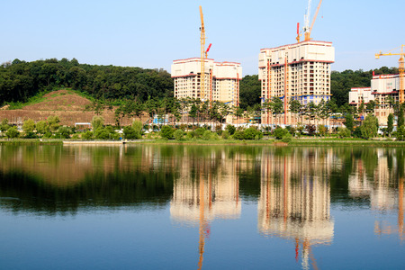 public housing: View of apartment buildings construction site with the lake