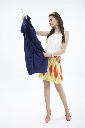 Woman selecting fashion item in a studio for dress