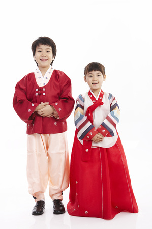 hanbok: Young children wearing korean costume isolated in white background Stock Photo