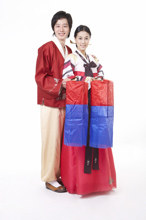 hanbok: Asian couple wearing traditional korean costume posing in a studio with traditional lanterns Stock Photo
