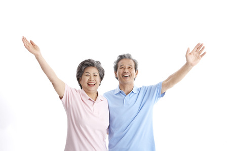 Asian elderly couple posing in a studio with gesture Stock Photo