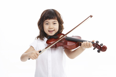 Young Asian girl playing the violin isolated in white