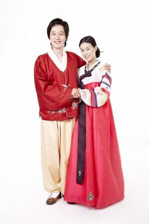 hanbok: Asian couple wearing traditional korean costume posing in a studio
