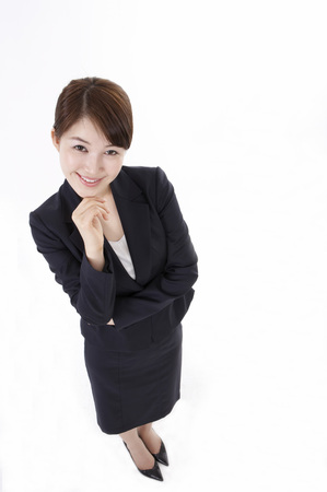 notion: Asian business woman in suit posing in a studio with gesture