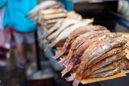 Fried fish stacked on the food stall