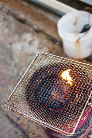 A briquette stove and double steel net grill