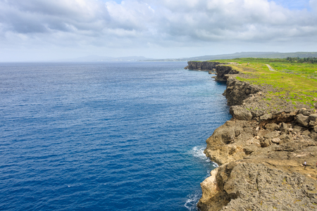 Aerial scenery of ocean and rock cliff shore Stock Photo