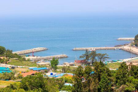 Slow city island - Aerial scenery of waterbreaks and ocean way into island